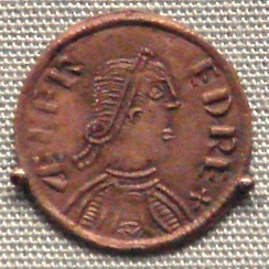 A coin of Alfred, king of Wessex, London, 880 (based upon a Roman model).Obv: King with royal band in profile, with legend: ÆLFRED REX ('King Alfred')