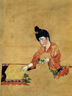 Fragmentary painting on silk of a woman playing the go boardgame, from the Astana Cemetery, Gaochang, c. 744 AD, during the late period of Tang Chinese rule (just before the An Lushan Rebellion)