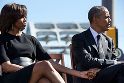 Michelle Obama and President Obama hold hands during an event commemorating the 50th anniversary of Bloody Sunday.