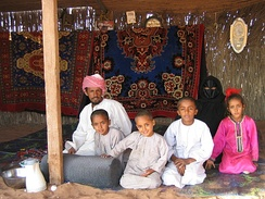 A Bedouin family in Wahiba Sands, Oman.