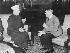 Haj Amin al-Husseini was a central figure of Palestinian nationalism in Mandatory Palestine. He took refuge in and collaborated with Nazi Germany during World War II. He met Adolf Hitler in December 1941. Scholarly opinion is divided on his antisemitsm, with many scholars viewing him as a staunch antisemite[297] while some deny the appropriateness of the term, or argue that he became antisemitic.[298]