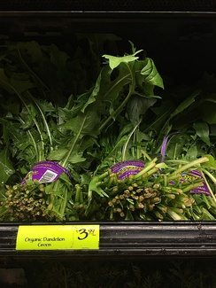 Bunches of organic dandelion greens for sale at Whole Foods