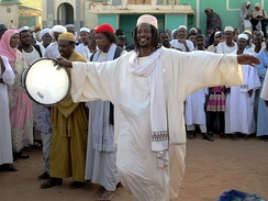 A Sufi dervish drums up the Friday afternoon crowd in Omdurman.