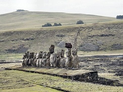 "Ahu Tongariki on Easter Island, with 15 moai made of tuff from Rano Raraku crater: The second moai from the right has a Pukao (""topknot"") which is made of red scoria."