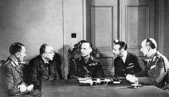 Meeting of the Anglo-Greek War Council ca. January 1941. Left to right: Major General Michael Gambier-Parry, Dictator Ioannis Metaxas, King George II of Greece, Air Vice Marshal John D'Albiac (RAF) and General Alexandros Papagos.