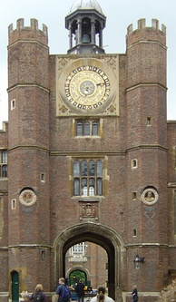 Anne Boleyn's Gate. The Tudor gatehouse and astronomical clock, made for Henry VIII in 1540 (C on plan above) Two of the Renaissance bas reliefs by Giovanni da Maiano can be seen set into the brickwork.