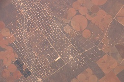 A New Mexico oil field, left, with crop circles on right, taken from the ISS in 2006.