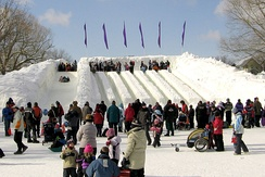 People on ice slides during Winterlude, an annual winter festival held in Ottawa.