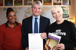 HIV campaigners, Memory Sachikonye (left) and Lennox (right) meet with the UK's Secretary of State for International Development Andrew Mitchell in December 2011