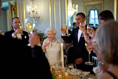 Hanks with Queen Elizabeth II and U.S. President Barack Obama at Winfield House in London