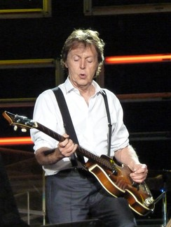 Paul McCartney mutes strings with picking hand.