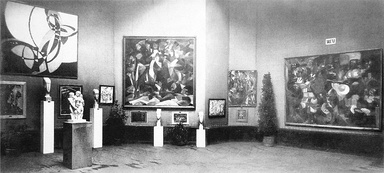 The Salon d'Automne of 1912, held in Paris at the Grand Palais from 1 October to 8 November. Kupka's Fugue in Two Colors is exhibited on the left. Other works are shown by Jean Metzinger (Dancer in a Café), Joseph Csaky (Groupe de femmes), Francis Picabia (La Source), Amedeo Modigliani (sculptures) and Henri Le Fauconnier (Mountaineers Attacked by Bears).