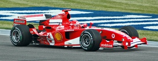 Schumacher in practice at the 2005 United States Grand Prix. Note the Bridgestone branding on the rear wing endplate, the Bridgestone's 'B' logo on the front wing, just under the nosecone and on the side winglet just before the rear wheel.