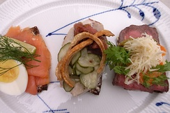 Smørrebrød, a variety of Danish open sandwiches piled high with delicacies