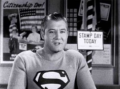 Actor George Reeves portraying Superman in Stamp Day for Superman. After appearing in film, he would be the first actor to star as Superman in television.