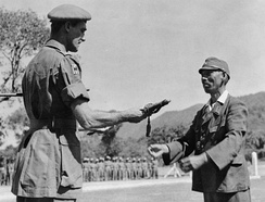 Lieutenant General Kawada, commander of the Japanese 31st Division, surrenders to Major General Arthur W Crowther, DSO, commander of the 17th Indian Division, near Moulmein, Burma.