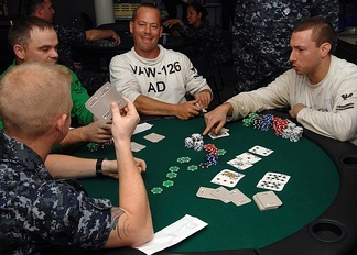"A game of Texas hold 'em in progress. ""Hold 'em"" is a popular form of poker."