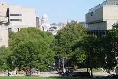 A view of the Wisconsin State Capitol from atop Bascom Hill. The Mosse Humanities building is on the right, Wisconsin Historical Society (fore) and Memorial Library (rear) on the left.