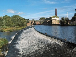 Weir on the River Wharfe at Otley with Garnett's paper mill behind