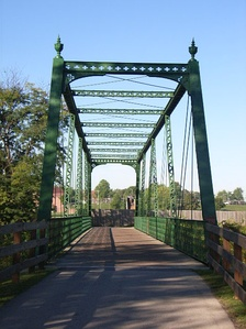 An old, restored truss bridge along the White Lick Creek Trail in Plainfield