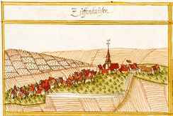 A drawing of Zuffenhausen from the west upon the Underland road in one of Andreas Kieser's books in 1682. St. John's Church towers in 17th century Zuffenhausen. The hill on the left is now the site of the Rotwegsiedlung. To the right is the site of modern Burgholzhof and the road up to Schnarrenberg. The valley between the two hills is the Haldenrain. Parts of the western and northeastern perimeter of the Etters, namely fences and hedges, are visible.