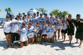The USC Trojans women's beach volleyball team poses with the National Championship trophy after winning the inaugural 2016 NCAA Beach Volleyball Championship.