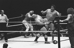 Roussimoff feuded with Big John Studd (left) in the build towards WrestleMania I, and later with King Kong Bundy (second from left)