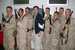 Brownback posing with U.S. troops in Iraq