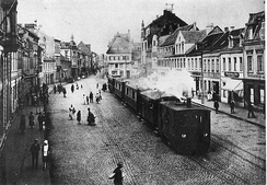 A steam tram engine from the Cologne-Bonn Railway, pulling a train through Brühl marketplace, c. 1900