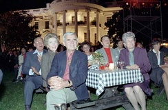 Laxalt, his wife, Carol, President Ronald Reagan, First Lady Nancy Reagan, Bob Michel and his wife, Corrine, watch the Oak Ridge Boys performance during the Barbecue for Members of Congress on the South Lawn in 1983