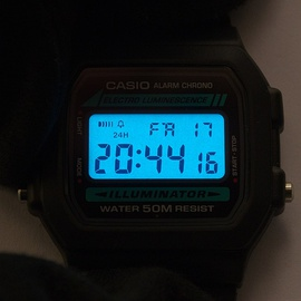 A Digital LCD watch with electroluminescent backlight.
