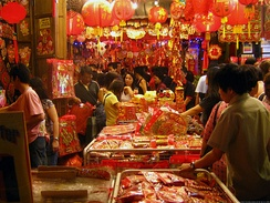 A street market in Chinatown during Chinese New Year holidays. In Chinese culture, red is the most auspicious color representing good fortune and happiness.