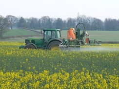 Spraying a crop with a pesticide