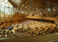 Seating in the debating chamber is arranged in a semicircle, with ministers sitting in the front section of the semicircle, directly opposite the presiding officer and parliamentary clerks.