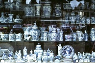 Shop window display of Delftware in the market place, Delft. East Asian-inspired Delftware, a lasting cultural and economic legacy of the VOC era.