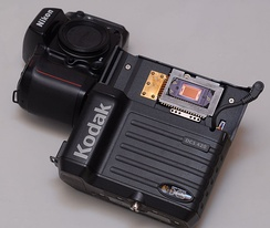 Kodak DCS420 digital camera, consisting of a modified Nikon N90s body (left) and a digital back (right) shown here separated.