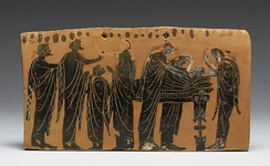 The lying in state of a body (prothesis) attended by family members, with the women ritually tearing their hair (Attic, latter 6th century BC)