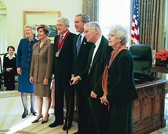 President George W. Bush and Laura Bush pose for a photo with Holbrook (center), a recipient of the National Humanities Medal in the Oval Office on November 14, 2003