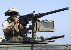 A U.S. Marine mans a .50 caliber machine gun as part of a security force during a training exercise with the 24th Marine Expeditionary Unit in November 2002.