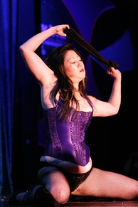 Cho performing burlesque at the 2006 Miss Exotic World Pageant.