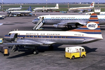 Airplanes and service vehicles on the apron in 1965