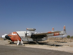 C-119C shown in Hemet Valley Flying Service livery as Tanker 82 before being retired; now at the Milestones of Flight Museum in Lancaster California. (note the jet pod above the fuselage).