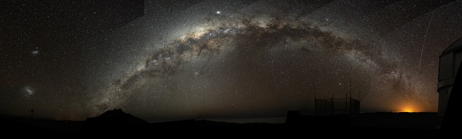 The Milky Way arch emerging from the Cerro Paranal, Chile in December 2009.