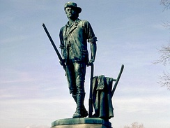 The Concord Minute Man of 1775 by Daniel Chester French, erected in 1875 in Concord, Massachusetts, depicting a typical minuteman