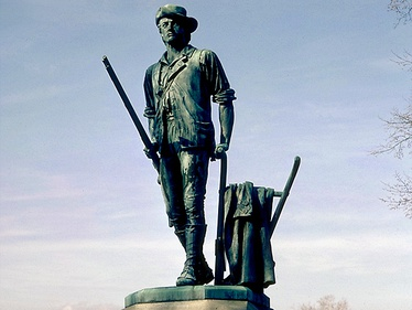 The U.S. ideal of the citizen soldier, in the militia, depicted by The Concord Minute Man of 1775, a monument created by Daniel Chester French and erected in 1875, in Concord, Massachusetts.