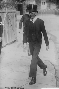"Prince Henry, Duke of Gloucester in 1914 dress of a junior Eton pupil, wearing a top hat, neck-tie and ""bum-freezer"", none of which are now worn"