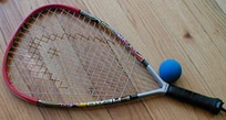 A typical racquetball racquet and ball