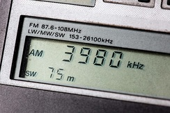 Portable shortwave receiver's digital display tuned to the 75 meter band