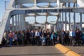 Then-President Obama, former President George W. Bush, and Civil Rights Movement veterans and other commemoration attendees marching across the Edmund Pettus Bridge in March, 2015