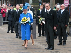 Queen Elizabeth II and Prince Philip hold nosegays by Rosemary Hughes as they leave Wakefield Cathedral after the 2005 Royal Maundy
